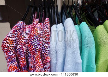 Color pullovers on hangers.