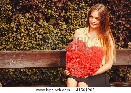 Cheering Girl Sitting On Bench.