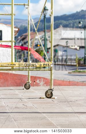 Cusco Peru - May 15: Scaffolding on a sidewalk with yellow warning tape as caution in the city of Cusco. May 15 2016 Cusco Peru.