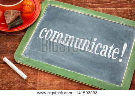 Communicate advice or reminder  - motivational text on a slate blackboard with chalk and cup of tea