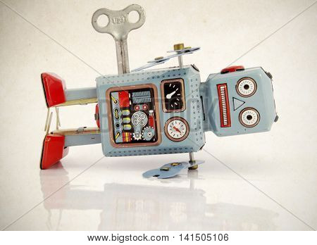 blue vintage robot toy in shock