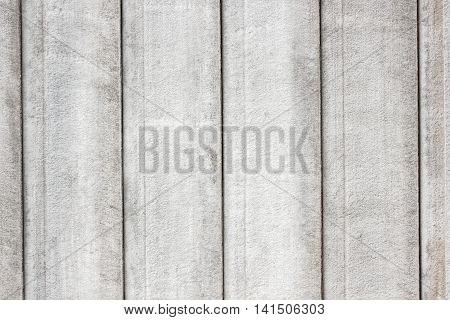White Concrete wall with plank wood texture/ concrete wall panels Concrete slab close-up good for patterns and backgrounds.