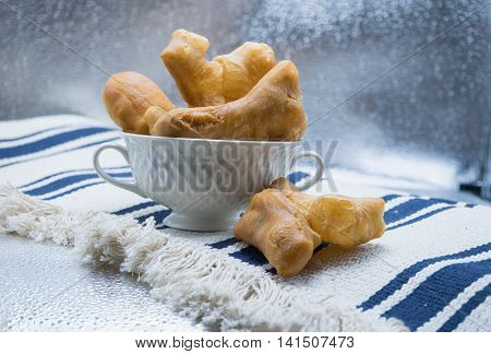 thai traditional deep fried dough stick served in white bowl ready to eat