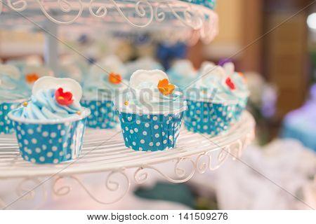 Wedding cupcakes on shelf wedding ceremony party