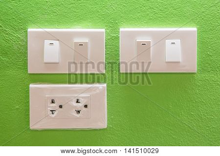switch on green wall background with lighting