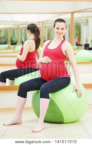 pregnant woman doing fitness ball exercise