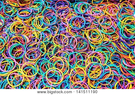 The colorful background of the rubber bands