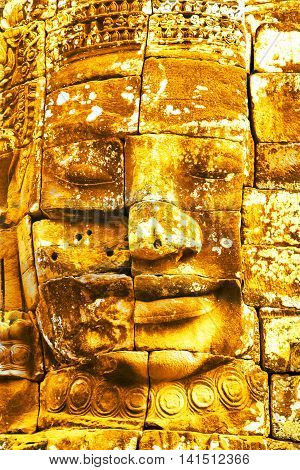 Gold Stone Head In Ancient Bayon Temple