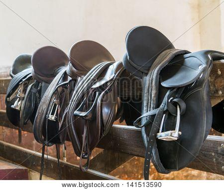 Rider Leather Saddles on fence cowboy rope leather
