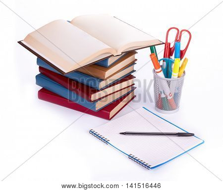 Pile of books, writing-book and pen on a white background. Concept for Back to school