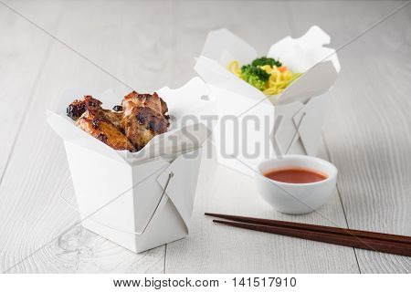 Chicken Wings And Noodles In Take Away Noodles Box