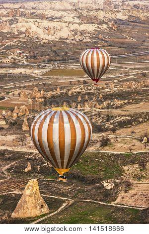 Two Air Balloons Soaring In Cappadocia Sky