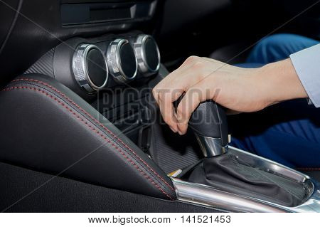 Human Hand Shifting Automobile Gear Inside The Car