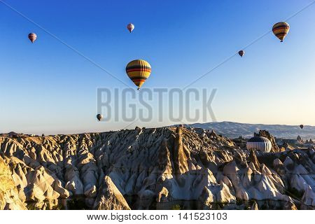 Small Group Of Hot Air Balloons Are Flying On Cappadocia