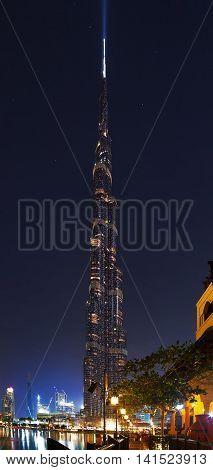 DUBAI UAE - JANUARY 23 2016: Vertical night panorama of Burj Khalifa tallest landmark building in the world 829.8 m. Dubai Burj Khalifa United Arab Emirates