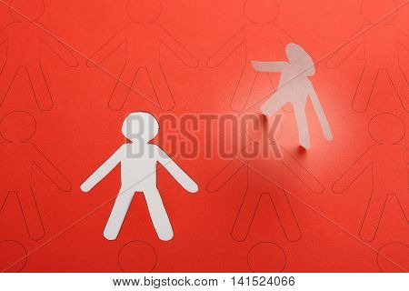 cutout paper person having been chosen among other candidates business or social concept