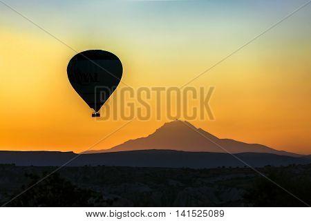 Hot Air Balloon At Sunset, Cappadocia, Turkey