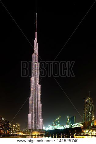 DUBAI UAE - JANUARY 23 2016: Night panorama of Burj Khalifa tallest building in the world 829.8 m. Dubai Burj Khalifa United Arab Emirates