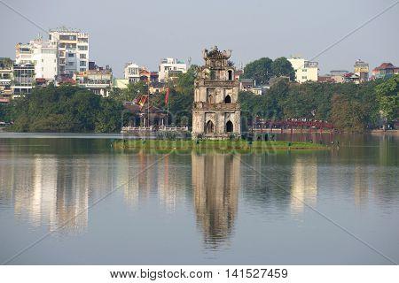 HANOI, VIETNAM - DECEMBER 13, 2015: View of the Turtle tower on the Lake of the returned sword. Religious landmark  of the city Hanoi, Vietnam