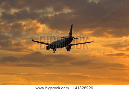 SAINT PETERSBURG, RUSSIA - JULY 03, 2016: Airbus A320-214 (VQ-BDM) airlines Ural Airlines flies into sunset sky