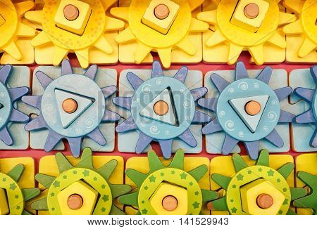 Colorful wooden cogwheel toy for a kid