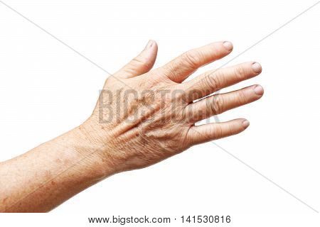 Old female hand full of freckles isolated