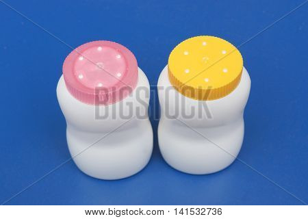 Baby talcum powder container on blue background