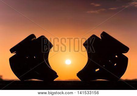 Taekwondo head guards with sunset silhouette background
