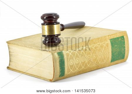 Wooden gavel and big book of law