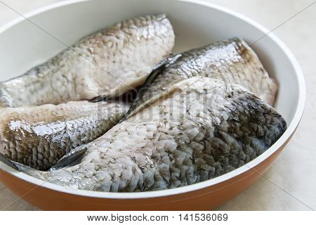 In a large frying pan fish carp cleaned and washed. Cooked frying.