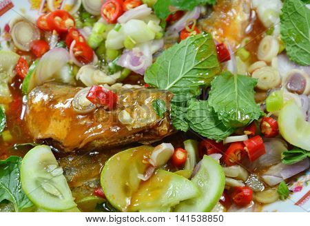 Thai spicy canned sardine salad on the dish