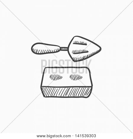 Spatula with brick vector sketch icon isolated on background. Hand drawn Spatula with brick icon. Spatula with brick sketch icon for infographic, website or app.