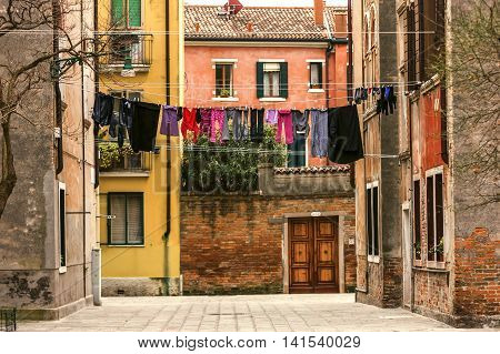 Typical Italian Back Street Scene With Washing Hanging On Line
