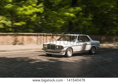 Lviv Ukraine - June 12 2015:Old retro car Mercedes Benz CE 230 taking participation in race Leopolis grand prix 2015 Ukraine.
