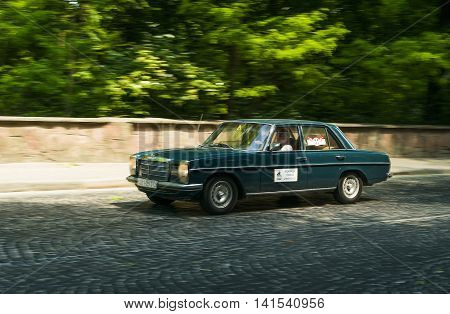 Lviv Ukraine - June 12 2015:Old retro car Mercedes Benz 115 taking participation in race Leopolis grand prix 2015 Ukraine.