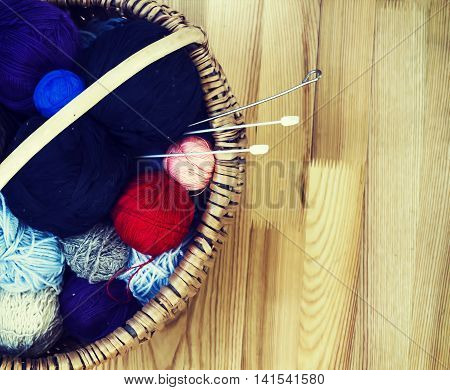 knitting wool color balls with needles in the basket