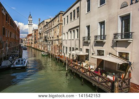 Canal Among Houses In Venice, Italy