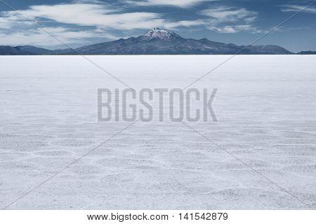 The world's largest salt flat and dormant volcano Tunupa at the far background, Salar de Uyuni, Bolivia
