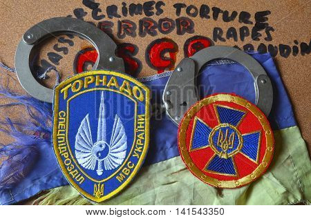 ILLUSTRATIVE EDITORIAL.Chevron of Ukrainian  battalion Tornado in Police.The battalion disbanded for pederastic rapes kids,marauding and torture.August 7 ,2016 in Kiev, Ukraine
