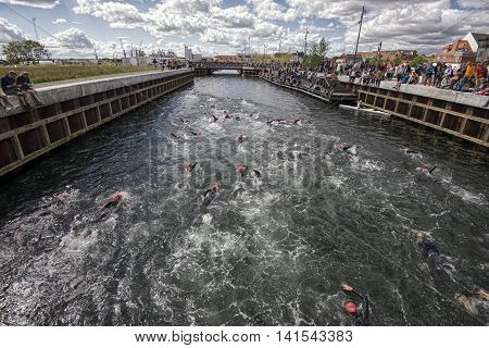 FREDERICIA DENMARK - AUGUST 6 2016: Triathletes on start of the triathlon competition Challenge Denmark in Fredericia hatbor canal August 6 2016.