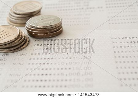 notebook passbook report money deposit and coins