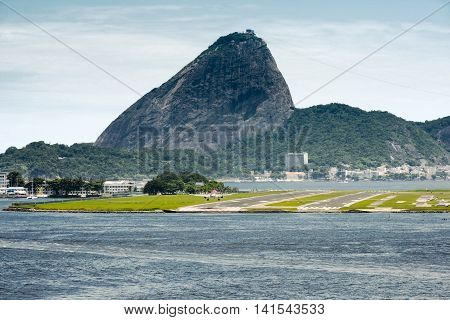 View Of A Passenger Airplane Landing At The Rio De Janeiro Airport With The City At The Background, Brazil