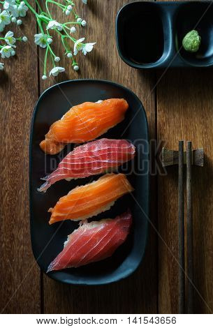 Salmon and tuna sushi with chopsticks Japanese food
