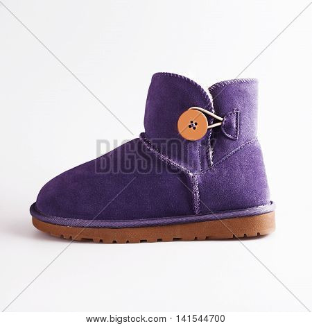 stylish female winter boots over white background