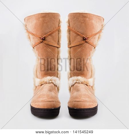 stylish beige winter female boots over white