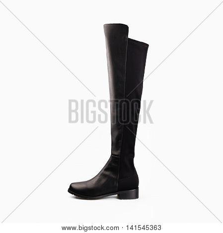 winter female black boot over white background
