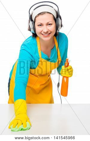 Girl In Headphones Rubbing White Table A Rag Isolated