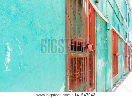 Orange Gates on Green Wall in Curacao