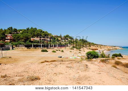 Village and the sand beach. Pinus Village in Sardinia Italy.02.08.2016.
