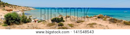The beach Pinus Village with sand and rock in Sardinia Italy.